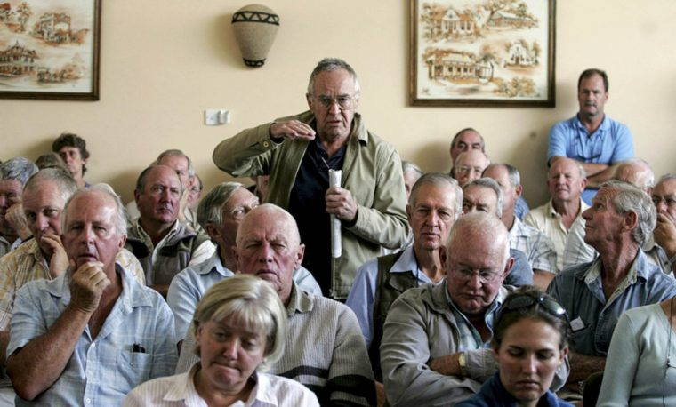 white farmers bace themselves up